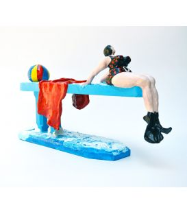 The swimmer with black and red dots swimsuit on the diving board