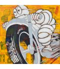 Michelin Man on a grey motorcycle