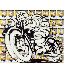 Michelin on a black motorbike on a background of old advertisements for Total oil