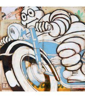 Bonhomme Michelin sur une moto bleue